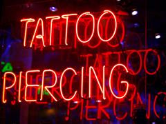Tattoo Piercing Sign in red coloured lights