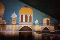 Photo of mural featuring a middle eastern style palace - painted on the walls of historic Bates Building
