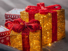 image of a set of red, gold and white gift boxes