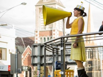 Girl with yellow speaker