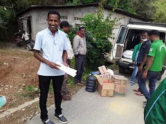 Health workers distributing COVID-19 supplies