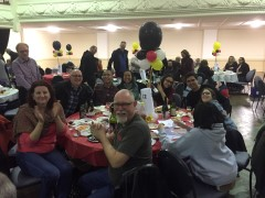 Guests at winnig table celebrate Trivia success