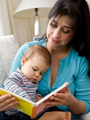 Mother reading to baby